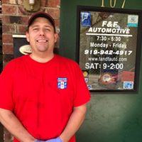F & F Automotive owner standing next to the front door of his business