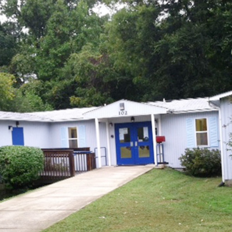 Front door and front windows of the Community School for People Under Six childcare center