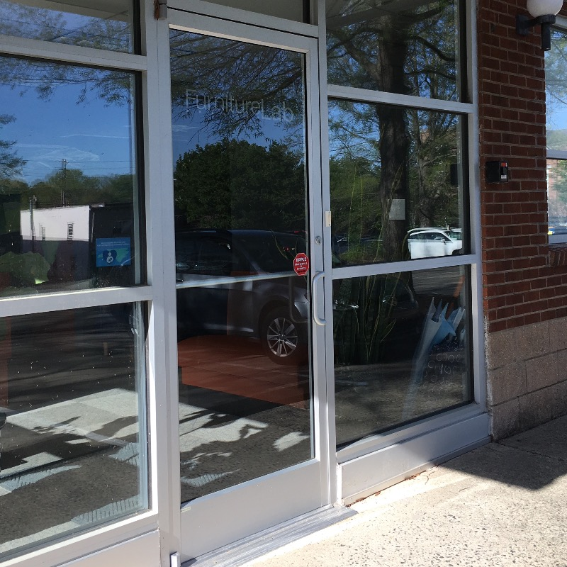 Front door and front windows of Furniture Lab business