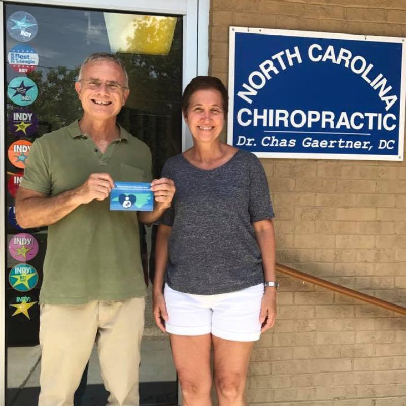 NC Chiropractic office front door with two employees standing in front of door