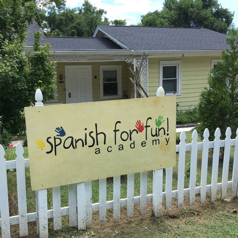 Fence with sign and front door of Spanish for Fun Academy childcare
