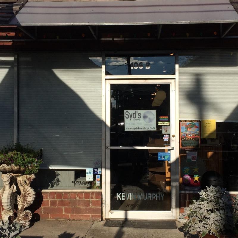 Syd's storefront door and windows