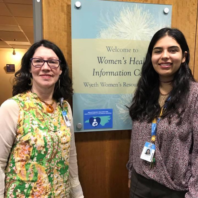 Two UNC Hospital Women's Center employees standing in front of the door to the center